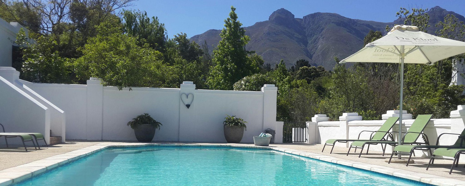 large pool area at 5 star De Kloof Luxury Estate boutique hotel and spa Swellendam Western Cape South Africa